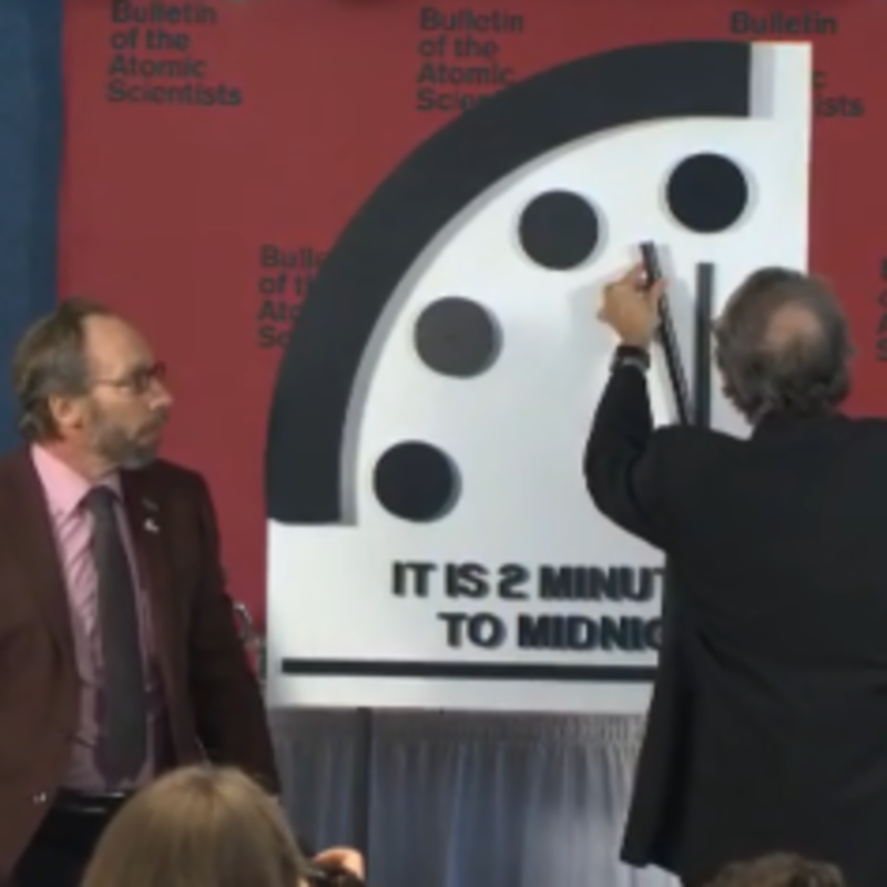 Robert Rosner, the chair of the Bulletin Science and Security Board moves the Doomsday Clock up to 2 minutes to midnight as Lawrence Krauss, the chair of the Board of Sponsors, looks on.